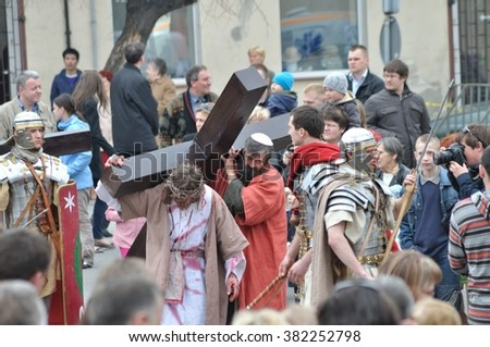 GORA KALWARIA - APRIL 17, 2011: Jesus carrying his cross, on the way to his crucifixion, during the street performances Mystery of the Passion. - stock photo