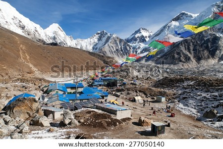 Gorak Shep village with prayer flags, way to Kala Patthar and Mount Everest base camp, Sagarmatha national park, Khumbu valley, Nepal - stock photo
