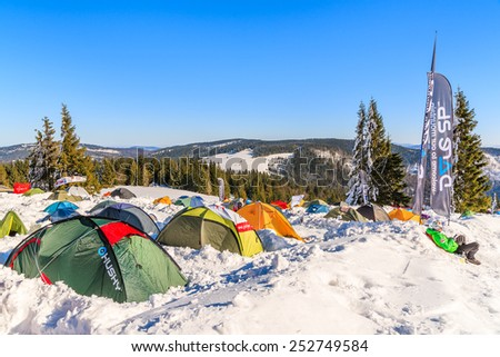 GORCE MOUNTAINS, POLAND - FEB 14, 2015: colorful tents of winter camp located near Turbacz shelter. Every February tourists learn climbing and survival techniques in winter time.