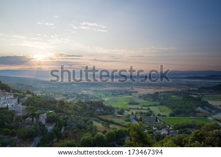Gordes valley during sunrise - stock photo