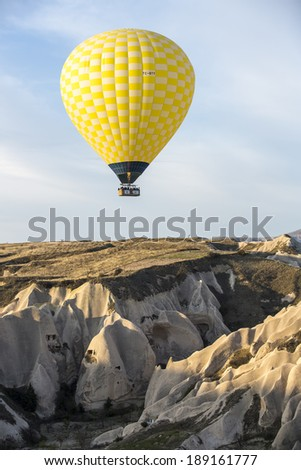 GOREME, TURKEY - APRIL 6: Hot air balloons flying over Cappadocia in Goreme, Turkey on April 6, 2014. The hot air balloon is a major tourist attraction for viewing the region's geological landscape.
