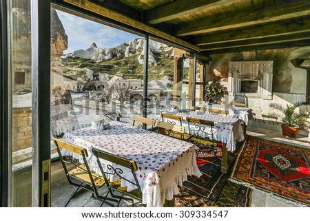 GOREME, TURKEY - APRIL 13, 2014: Interior of traditional dining room cave house in Cappadocia ,The best historic mansions and cave restaurant for tourist in Goreme, Cappadocia, Turkey.