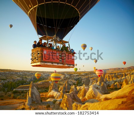 GOREME, TURKEY - AUGUST 25: Hot air balloon fly over Cappadocia on august 25, 2013 in Goreme, Cappadocia, Turkey. - stock photo