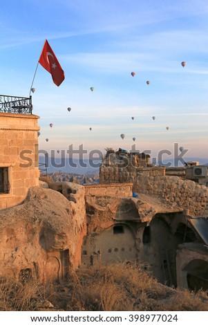 GOREME, TURKEY - DEC 10, 2015: Hot Air Balloon fly over Cappadocia, Turkey on Dec 10, 2015 on sunrise. Fairy Chimney, lava rock formation, are presented around Cappadocia, UNESCO Heritage City. - stock photo