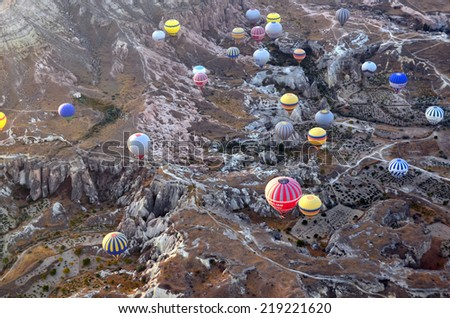 GOREME, TURKEY - OCTOBER, 02: Hot air balloon fly over Cappadocia is known around the world as one of the best places to fly with hot air balloons on october 02, 2013 in Goreme, Cappadocia, Turkey.  - stock photo