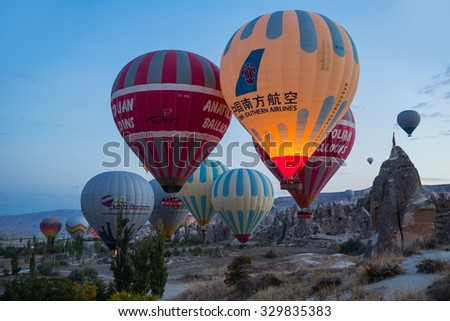 GOREME,TURKEY - OCTOBER 19, 2015: Roadies making ready a hot air balloon on the plains in Cappadocia, Turkey.