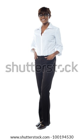Gorgeous african businesswoman posing hands in pocket, full-length shot - stock photo