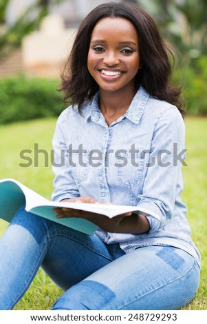 gorgeous african college student relaxing outdoors on campus