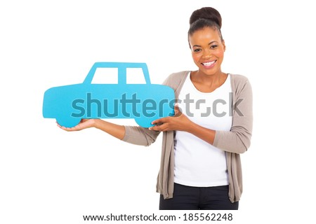 gorgeous african woman holding a car symbol on white background - stock photo