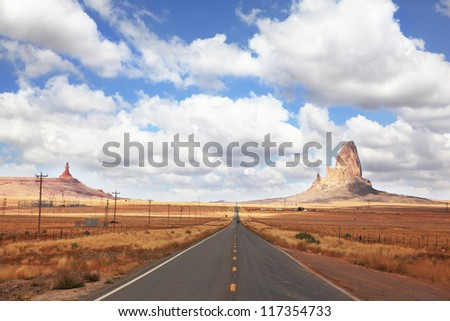 Gorgeous American Highway. Monument Valley in Utah on a cloudy windy day