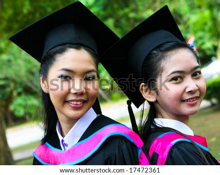 Gorgeous Asian university graduates celebrating their success.