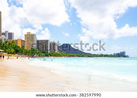 Gorgeous beach view with buildings and diamond head cliff on the island of Oahu, Hawaii. - stock photo