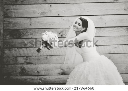 Gorgeous beautiful brunette  bride in white dress with bouquet.  - stock photo