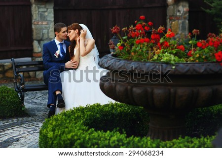 gorgeous beautiful happy young Caucasian couple posing in the garden restaurant, tenderness, Lviv, summer, emotions