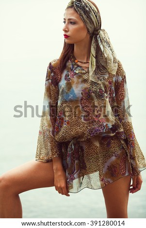 Gorgeous bikini woman standing on beach with nice figure wearing silk turban and pareo cover up beachwear - weight loss, fashion, luxury concept. Retro, vintage style. Outdoor shot - stock photo