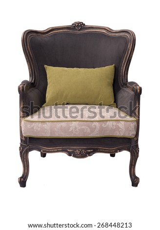 gorgeous black and ivory sitting chair with green pillow isolated on a white background
