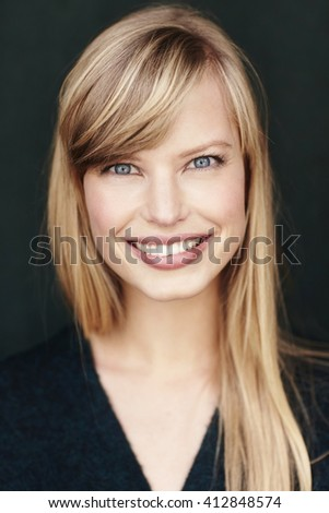 Gorgeous blond woman smiling at camera