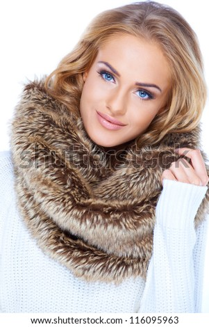 Gorgeous blond woman wearing winter fur scarf and smiling