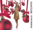 gorgeous blonde girl in elegant champagne color dress, red high heels and red gloves posing for christmas - stock photo
