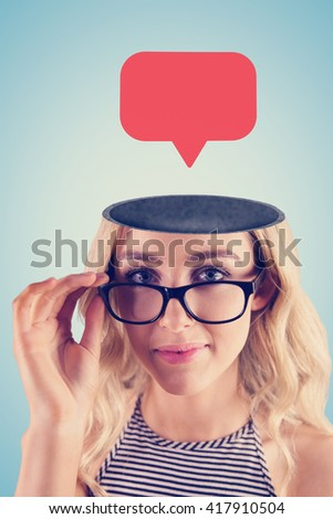 Gorgeous blonde hipster posing with glasses against blue background - stock photo