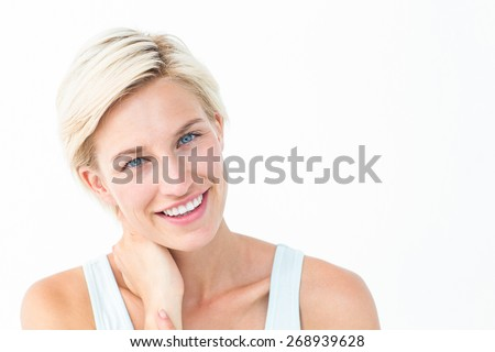 Gorgeous blonde smiling ta camera on white background - stock photo
