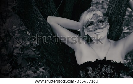 gorgeous blonde with carnival mask. Black and white photo - stock photo