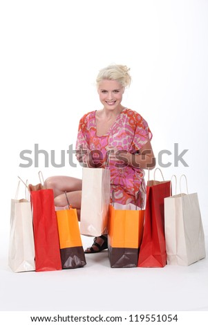 gorgeous blonde with shopping bags isolated on white - stock photo