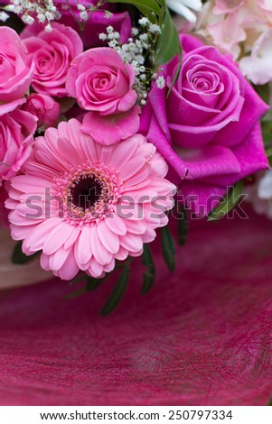 Gorgeous bouquet with pink roses and daysies (Gerbera) and white Chrysanthemum flowers on grass - stock photo