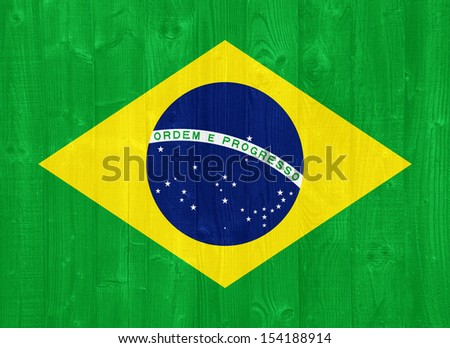 gorgeous Brazil flag painted on a wood plank texture - stock photo