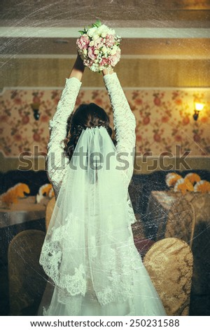 Gorgeous bride blonde in wedding dress in luxury interior with diamond jewelry posing at home and waiting for groom. Romantic rich brunette bride in a luxurious wedding dress in expensive interior - stock photo