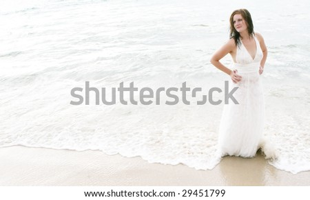 Gorgeous bride on the beach - tropical destination wedding.