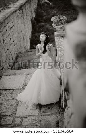 gorgeous bride outdoors posing, black and white - stock photo