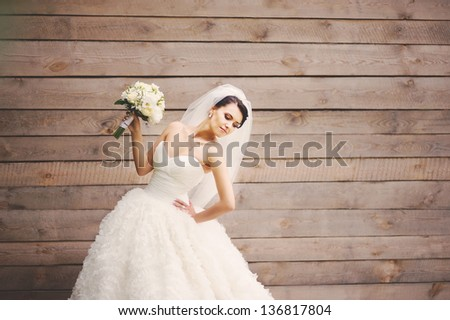 Gorgeous  Brunette bride with bouquet outdoor, posing - stock photo