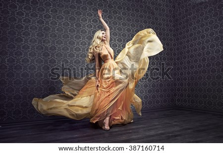 Gorgeous expressive blonde lady wearing fabulous dress