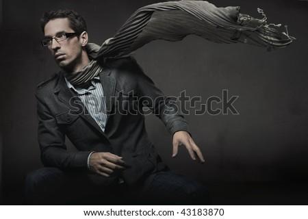 Gorgeous fashion style photo of an elegant man - stock photo