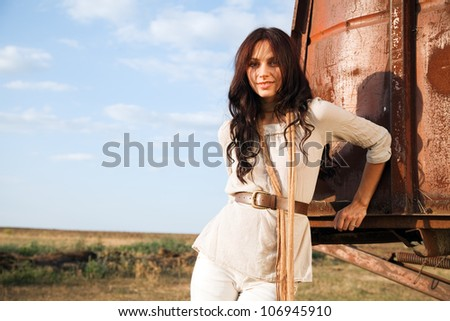 Gorgeous fashionable woman in countryside - stock photo