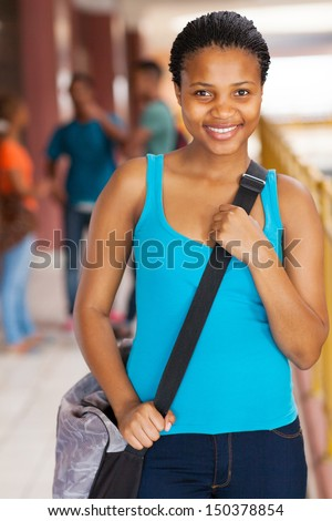 gorgeous female african american high school student on campus - stock photo