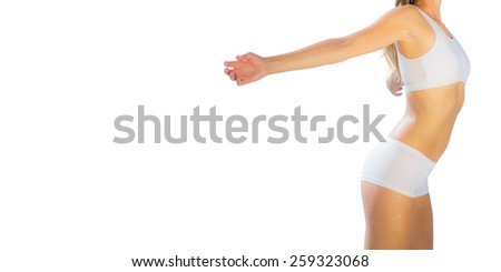 Gorgeous fit blonde standing with arms out while stretching - stock photo