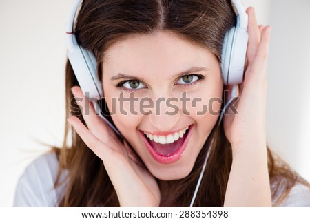 Gorgeous Funky Girl listening to Music - stock photo
