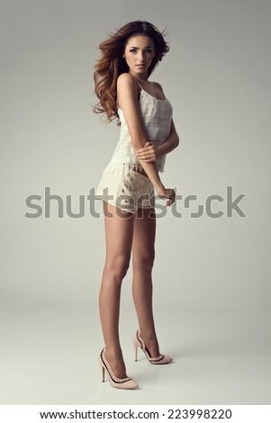 Gorgeous Girl posing in the studio. Fashion photo. - stock photo