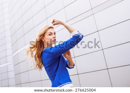 Gorgeous girl showing power - stock photo