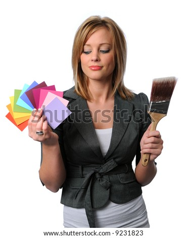 Gorgeous girl with paint brush and color swatches - stock photo
