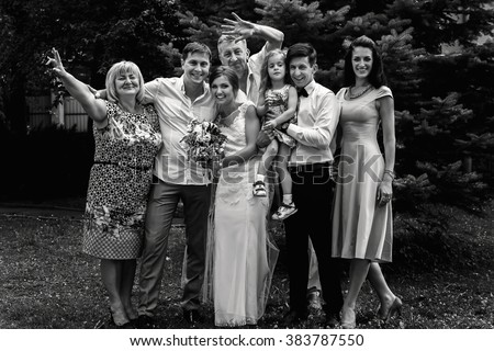 gorgeous happy bride and groom having photos with friends and family at wedding reception, cheerful moment - stock photo