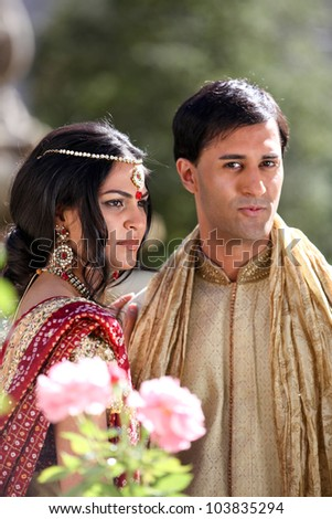 Gorgeous Indian bride and groom traditionally dressed - stock photo