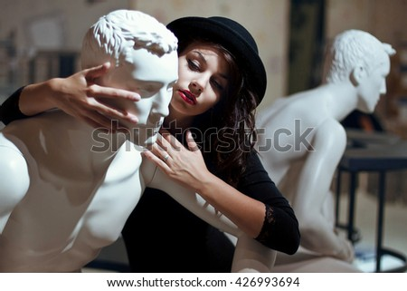 gorgeous interesting lady holds a dummy - stock photo
