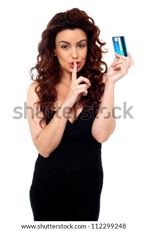 Gorgeous lady gesturing silence, holding credit card isolated over white - stock photo