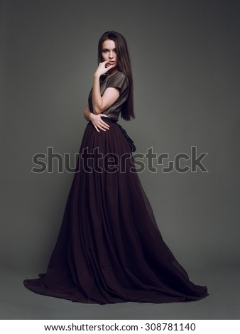Gorgeous Lady in Black Evening Dress with Loosing Long Hairs - stock photo