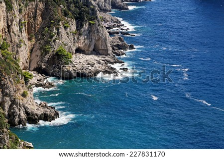 Gorgeous landscape of famous faraglioni rocks on Capri island, Italy. Capri is located on Tyrrhenian sea. It has been a resort since the time of Roman Republic. - stock photo