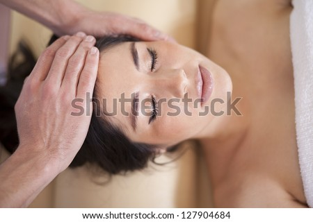 Gorgeous latin woman being pampered at a spa - stock photo