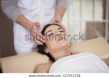 Gorgeous latin woman relaxing and being pampered at a spa - stock photo